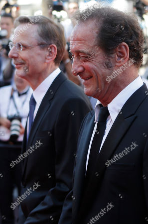 Actors Vincent Lindon, right, and Christophe Rossignon arrive for the screening of the film La Loi du Marche (The Measure of a Man) at the 68th international film festival, Cannes, southern France