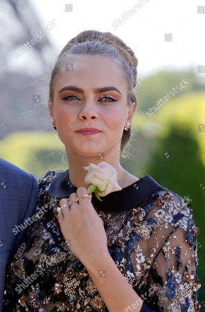 British Model Cara Delevingne attends the photocall for the movie Paper Towns (La Face Cachee de Margo) in Paris, France