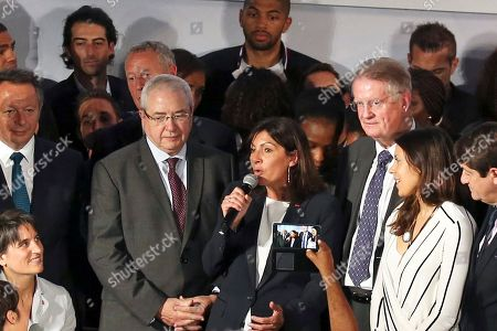 Paris mayor Anne Hidalgo, center, announces the candidacy of Paris for the 2024 Olympic games, in Paris, . Paris declared its candidacy for the 2024 Olympics on Tuesday, becoming the fourth city to enter the race and setting out its vision for bringing the games back to the French capital for the first time in 100 years. Standing at left is the President of Paris region Jean-Paul Huchon and at right the President of the International Rugby Federation Bernard Lapasset