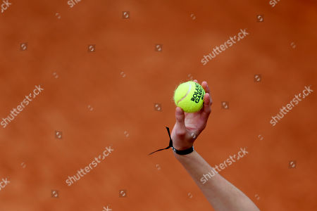 A ball girl presents a tennis ball as Serbia's Jelena Jankovic plays Bulgaria's Sesil Karatantcheva during their first round match of the French Open tennis tournament at the Roland Garros stadium, in Paris