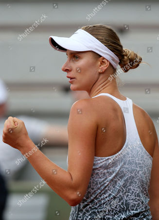 Bulgaria's Sesil Karatantcheva clenches her fist as she plays Serbia's Jelena Jankovic during their first round match of the French Open tennis tournament at the Roland Garros stadium, in Paris