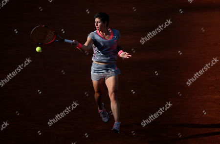 Spain's Carla Suarez Navarro returns the ball to France's Virginie Razzano during their second round match of the French Open tennis tournament at the Roland Garros stadium, in Paris
