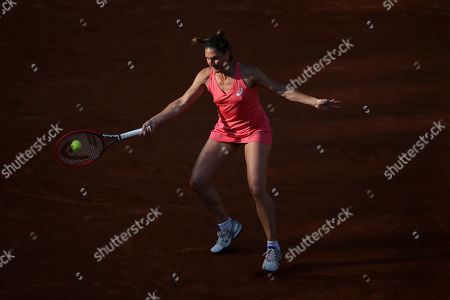 France's Virginie Razzano returns the ball to Spain's Carla Suarez Navarro during their second round match of the French Open tennis tournament at the Roland Garros stadium, in Paris