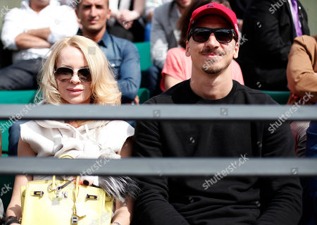 Paris Saint Germain strike Zlatan Ibrahimovic, of Sweden, and his wife Helena Seger watch Serbia's Novak Djokovic playing Luxembourg's Gilles Muller during their second round match of the French Open tennis tournament at the Roland Garros stadium, in Paris