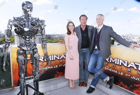 British actress Emilia Clarke, left, Arnold Schwarzenegger, center and Director Alan Taylor, pose to photographers at a preview of his new film Terminator Genisys in Paris, France