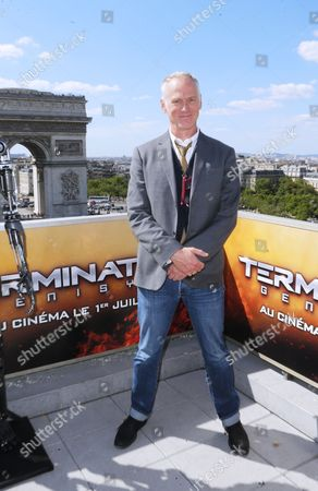 US director Alan Taylor, poses for photographers at a preview of the film, 'Terminator: Genisys', in front of Arch of Triumph, in Paris, France
