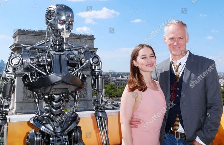 British actress Emilia Clarke, and US director Alan Taylor, poses for photographers, at a preview of the new film, 'Terminator: Genisys', in Paris, France