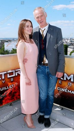 British actress Emilia Clarke, left and US director Alan Taylor, poses for photographers, at a preview of the new film, 'Terminator: Genisys', in Paris, France