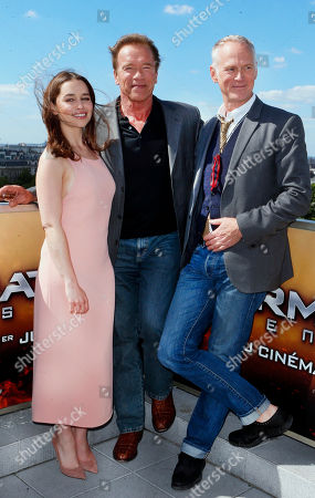 From left, British actress Emilia Clarke, Austrian born actor Arnold Schwarzenegger, center, and US director Alan Taylor, pose for photographers at a preview of the film, 'Terminator: Genisys', in front of Arch of Triumph, in Paris, France