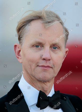 German musician Max Raabe arrives for an official state dinner for Britain's Queen Elizabeth II, in front of Germany's President Joachim Gauck's residence, Bellevue Palace, in Berlin