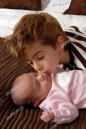 Finlay kisses his sleeping sister Amy