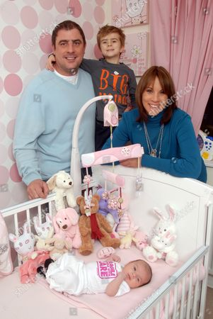Andrea McLean with partner Steve Toms and children Finlay and baby Amy in the nursery