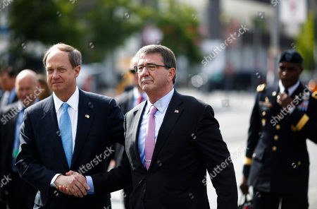 "John B. Emerson, Ashton Carter U.S. Defense Secretary Ash Carter, center, shakes hands with U.S. Ambassador to Germany John B. Emerson, left, after a wreath laying ceremony at the Holocaust Memorial in Berlin, Germany, . Carter, who is attending his first NATO meeting as defense secretary this week, said that the U.S. and NATO need to have a ""strong but balanced"" approach to deter Russia's military actions but at the same time needing Moscow to fight terrorism and hammer out a nuclear agreement with Iran"
