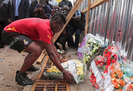Asamoah Gyan Ghanaian soccer player Asamoah Gyan, places flowers at the site of a fuel station that exploded in Accra, Ghana, . As the country mourned the victims at a national service on Wednesday, June 10, the Ghanaian government is facing allegations that poorly managed city planning contributed to the tragedy