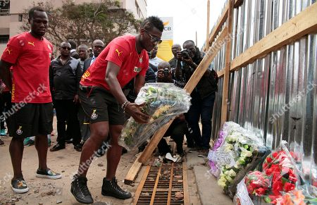 Asamoah Gyan Ghanaian soccer player Asamoah Gyan, center, places flower's at the site of a fuel station that exploded in Accra, Ghana, . As the country mourned the victims of the explosion at a national service Wednesday, June 10, the Ghanaian government is facing allegations that poorly managed city planning contributed to the tragedy