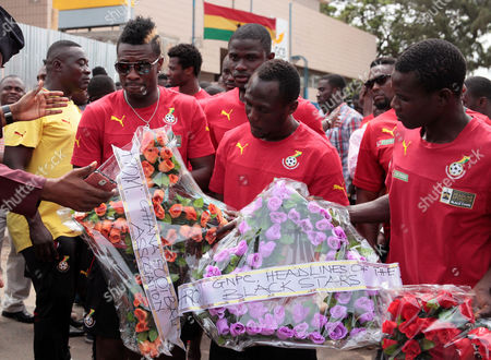 Asamoah Gyan Ghanaian Black Star soccer player Asamoah Gyan, left, with flower's as he and other players visit the site of the fuel station that exploded in Accra, Ghana, . The flooding in the capital last week caused fuel from a gas station to ignite, killing at least 160 people. As the country mourned the victims at a national service Wednesday, June 10, the Ghanaian government is facing allegations that poorly managed city planning contributed to the tragedy