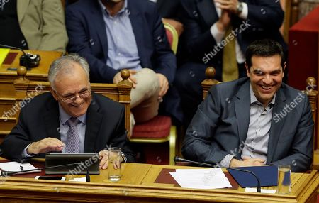 Alexis Tsipras, Giannis Dragasakis Greece's Prime Minister Alexis Tsipras, right, and Deputy Prime Minister Giannis Dragasakis laugh during a parliament meeting in Athens, . Lawmakers have been summoned to emergency sessions in parliament after Prime Minister Alexis Tsipras sought authorization to negotiate a new bailout deal with European creditors