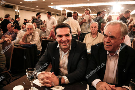"Alexis Tsipras, Yannis Dragasakis Greece's Prime Minister Alexis Tsipras, center, and his Deputy Yannis Dragasakis, attend a Syriza party central committee meeting in Athens, Greece, on . Tsipras has told leaders of the governing Radical Left Coalition that Greece is ready to accept a ""viable and long lasting"" deal with its lenders, but not on ""humiliating terms"