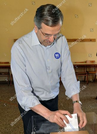 Antonis Samaras Former Greek Prime Minister and conservative opposition leader Antonis Samaras casts his vote at a polling station in the town of Pylos, southwestern Greece, . Greeks were voting Sunday in a bailout referendum that will decide the country's future, with opinion polls showing people evenly split on whether to accept creditors' proposals for more austerity in exchange for rescue loans or defiantly reject the deal