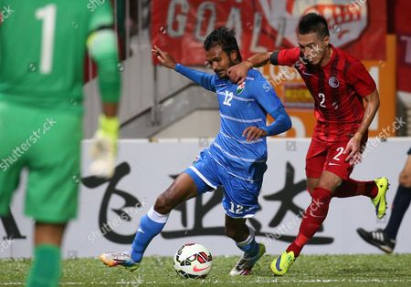 Ashadh Ali, Lee Chi Ho Ashadh Ali of Maldives, center, fights for the ball with Lee Chi Ho of Hong Kong, right, during their 2018 World Cup Asian qualifying match in Hong Kong, . Hong Kong won 2-0
