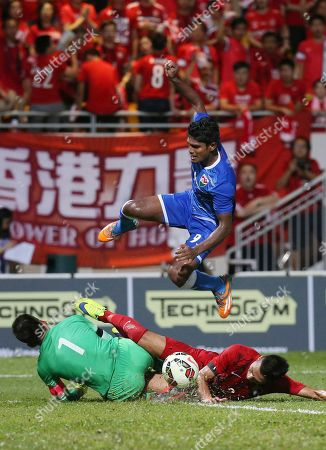 Asadhulla Abdulla, Yapp Hung Fai, Lee Chi Ho Asadhulla Abdulla of Maldives, top, jumps as he is blocked by Hong Kong's goalkeeper Yapp Hung Fai, left, and Lee Chi Ho during their 2018 World Cup Asian qualifying match in Hong Kong