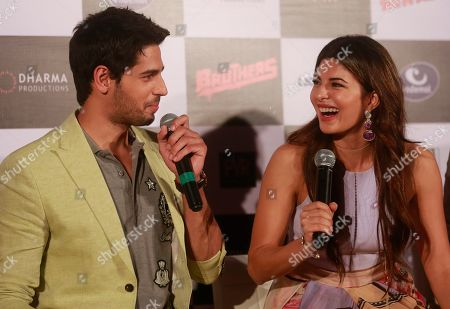Jacqueline Fernandez, Sidharth Malhotra Bollywood actress, Jacqueline Fernandez right, shares a lighter moment with co star Sidharth Malhotra during the trailer launch of their upcoming film 'Brothers' in Mumbai, India, .The film is scheduled for release on August 14, 2015