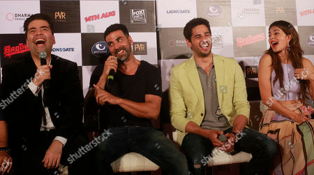 Bollywood film producer Karan Johar left, shares a lighter moment with actors, Akshay Kumar, second left, Jacqueline Fernandez right, and Sidharth Malhotra second right during the trailer launch of their upcoming film 'Brothers' in Mumbai, India, .The film is scheduled for release on August 14, 2015