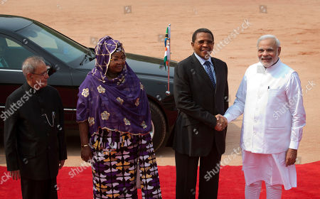 Indian Prime Minister Narendra Modi, right, welcomes Tanzanian President Jakaya Kikwete as Indian President Pranab Mukherjee, and Tanzanian President's wife Salma Kikwete pose for the media at the Indian presidential palace, in New Delhi, India, . President Kikwete is on a five day official visit to India