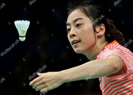 China's Wang Shixian serves against Bae Yeon-ju of South Korea during their women's singles second round match at the Indonesia Open badminton tournament in Jakarta, Indonesia