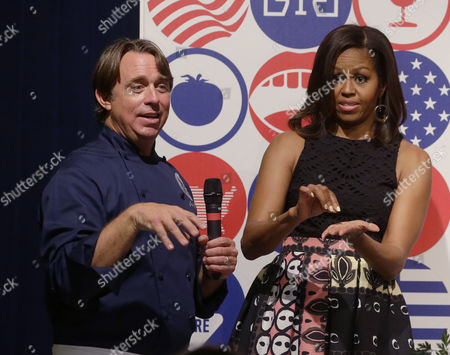 U.S. first lady Michelle Obama participates in a cooking demonstration with cook John Besh at the James Beard American Restaurant with Italian and American middle school students in Milan, Italy, . Michelle Obama is in Milan on the second leg of a European trip that puts an international spin on her core initiatives