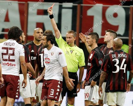 AC Milan's Cristian Zaccardo, second from left, receive a red card by referee Paolo Valeri during the Serie A soccer match between AC Milan and Torino at the San Siro stadium in Milan, Italy