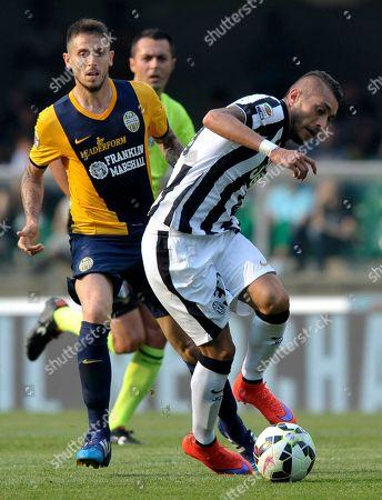 Verona's Leandro Greco, left, vies for the ball with Juventus' Roberto Pereyra, during their Serie A soccer match at Verona's Bentegodi stadium, Italy