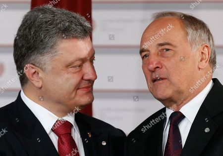 Ukrainian President Petro Poroshenko, left, speaks with Latvian President Andris Berzins as he arrives for a formal dinner at the Eastern Partnership summit in Riga, on . EU leaders on Thursday will seek new ways to bolster ties with six post-communist nations in Eastern Europe, a year and a half after a previous summit of the Eastern Partnership ended with a fateful standoff over Ukraine