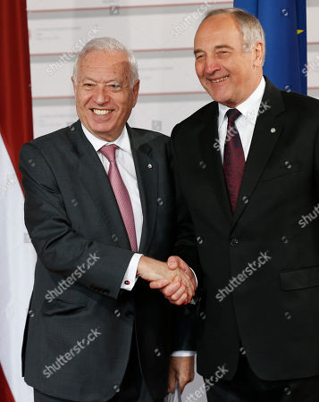 Spanish Foreign Minister Jose Manuel Garcia-Margallo, left, is greeted by Latvian President Andris Berzins as he arrives for a formal dinner at the Eastern Partnership summit in Riga, on . EU leaders on Thursday will seek new ways to bolster ties with six post-communist nations in Eastern Europe, a year and a half after a previous summit of the Eastern Partnership ended with a fateful standoff over Ukraine