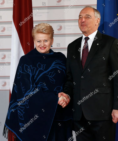 Lithuanian President Dalia Grybauskaite, left, is greeted by Latvian President Andris Berzins as he arrives for a formal dinner at the Eastern Partnership summit in Riga, on . EU leaders on Thursday will seek new ways to bolster ties with six post-communist nations in Eastern Europe, a year and a half after a previous summit of the Eastern Partnership ended with a fateful standoff over Ukraine