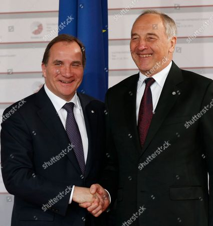 Swedish Prime Minister Stefan Lofven, left, is greeted by Latvian President Andris Berzins as he arrives for a formal dinner at the Eastern Partnership summit in Riga, on . EU leaders on Thursday will seek new ways to bolster ties with six post-communist nations in Eastern Europe, a year and a half after a previous summit of the Eastern Partnership ended with a fateful standoff over Ukraine