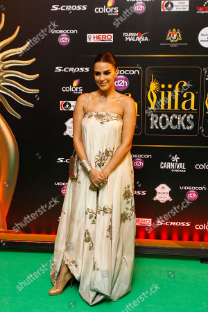 """Neha Dhupia Bollywood actress Neha Dhupia arrives on the """"green carpet"""" for the IIFA Rocks! concert as part of the three-day long International Indian Film Academy (IIFA) awards held in Kuala Lumpur, Malaysia on . The 16th IIFA is scheduled for June 5-7 in Malaysia"""