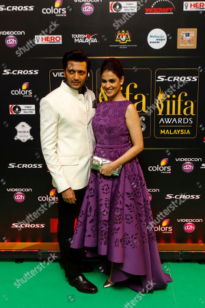 """Stock Photo of Riteish Deshmukh, Genelia D'Souza Bollywood actor Riteish Deshmukh poses with wife and actress Genelia D'Souza as they arrive on the """"green carpet"""" for the IIFA Rocks! concert as part of the three-day long International Indian Film Academy (IIFA) awards held in Kuala Lumpur, Malaysia, . The 16th IIFA is scheduled for June 5-7 in Malaysia"""