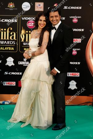 Stock Picture of Ritesh Deshmukh, Genelia D'souza Bollywood couple Ritesh Deshmukh, right and Genelia D'souza pose on the green carpet at the International Indian Film Academy (IIFA) awards in Kuala Lumpur, Malaysia, . The three day event concludes Sunday