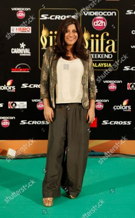 Zoya Akhtar Bollywood director Zoya Akhtar poses on the green carpet at the International Indian Film Academy (IIFA) awards in Kuala Lumpur, Malaysia, . The three day event concludes Sunday