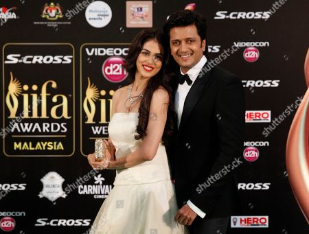 Ritesh Deshmukh, Genelia D'souza Bollywood couple Ritesh Deshmukh, right and Genelia D'souza pose on the green carpet at the International Indian Film Academy (IIFA) awards in Kuala Lumpur, Malaysia, . The three day event concludes Sunday