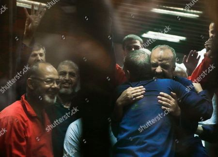 Mohammed el-Beltagy, Essam el-Erian, Khairat el-Shater Senior Muslim Brotherhood leaders Mohammed el-Beltagy, right, hugs Essam el-Erian in a makeshift courtroom at the Police Academy courthouse in Cairo, Egypt, . An Egyptian court confirmed a death sentence for el-Beltagy over charges of conspiring with foreign groups. The court also confirmed death sentences handed to el-Erian over a mass prison break during the 2011 uprising