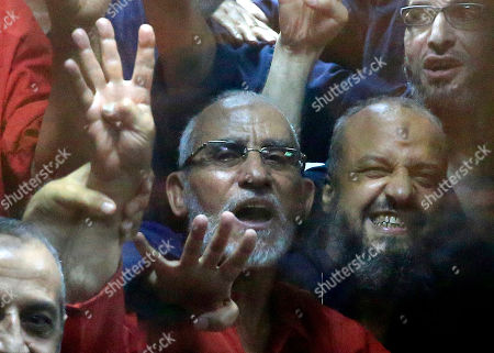Mohammed Badie, Mohammed el-Beltagy Egyptian defendants including the spiritual leader of the Muslim Brotherhood, Mohammed Badie, left, and Senior Muslim Brotherhood leader Mohammed el-Beltagy, right, make a four-fingered gesture referring to the 2013 killing of Muslim Brotherhood protesters at the Rabaah Al-Adawiya mosque, in a makeshift courtroom at the Police Academy courthouse in Cairo, Egypt, . An Egyptian court on Tuesday confirmed a death sentence handed to ousted Egyptian President Mohammed Morsi over a mass prison break during the 2011 uprising that eventually brought him to power. The judge also confirmed death sentences for five other jailed leading members of Morsi's Muslim Brotherhood, including Badie, the group's leader, and Saad el-Katatni, the head of its short-lived political party