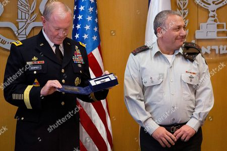 Martin Dempsey, Gadi Eizenkot Outgoing Joint Chiefs Chairman Gen. Martin Dempsey, left, looks at a gift from Israeli Chief of Staff Lt. Gen. Gadi Eizenkot after reviewing an honour guard during a welcoming ceremony in a military base in Tel Aviv, Israel, . The Chairman of the U.S. Joint Chiefs of Staff General Martin E. Dempsey landed on Monday evening in Israel for an official visit