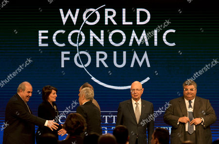 Iyad Allawi, Abdullah Ensour, Jahjaga Atifete Iraq's, Vice President Iyad Allawi, left shakes hands with Jordan's Prime Minister Abdullah Ensour, while Kosovo's President Jahjaga Atifete, second left shakes hands with Iraqi Deputy Prime Minister Saleh al-Mutlaq, next to Klaus Schwab, WEF's Founder and Executive Chairman, second right and head of the Kuwaiti Danish Dairy Company Jaafar Mohammed, following the closing session of the World Economic Forum at the King Hussein convention center, Dead Sea resort of Southern Shuneh, Jordan