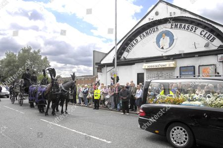 The funeral procession of comedian Bernard Manning arrives outside the World Famous Embassy Club