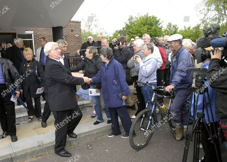 Frank Carson greets mourners