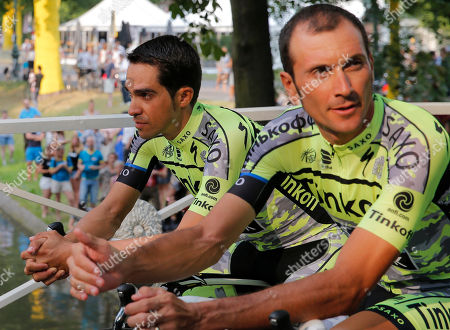 Spain's Alberto Contador, left, waits with teammate Ivan Basso of Italy for the team presentation in Utrecht, Netherlands, two days ahead of the start of the Tour de France cycling race