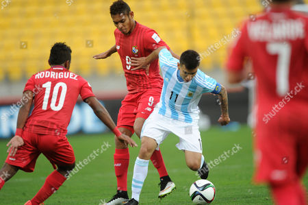 Argentina's Angel Correa, second right, battles to keep the ball as Panama defenders Jhamal Rodriguez, left, Ismael Diaz and Julian Velarde, right, attempt to take the ball during their U20 soccer World Cup match in Wellington, New Zealand