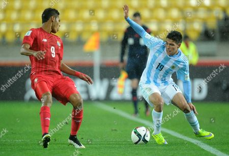 Argentina's Emi Buendia, right, looks to take the ball past Panama's Ismael Diaz during their U20 soccer World Cup match in Wellington, New Zealand